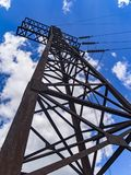 Image of high voltage power line and sky. High voltage electricity pylons and transmission power lines on the blue sky background Stock Image