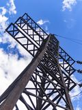 Image of high voltage power line and sky. High voltage electricity pylons and transmission power lines on the blue sky background Stock Photos