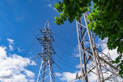 Image of high voltage power line and sky. High voltage electricity pylons and transmission power lines on the blue sky background Royalty Free Stock Images