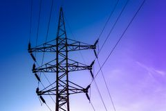 Image of high voltage power line and sky. High voltage electricity pylons and transmission power lines on the blue sky background Royalty Free Stock Photography