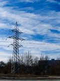 Image of high voltage power line and sky. High voltage electricity pylons and transmission power lines on the blue sky background Royalty Free Stock Image