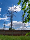 Image of high voltage power line and sky. High voltage electricity pylons and transmission power lines on the blue sky background Royalty Free Stock Photos