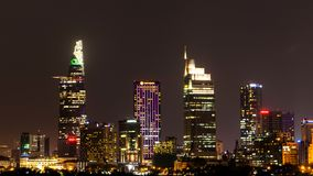 City Scene with Modern Buildings in Ho Chi Minh City's Central Business District by Night royalty free stock photo