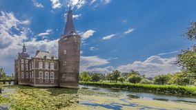 Image of Hoensbroek castle surrounded by water stock photography