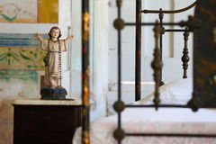 Image. Of a holy person standing on a nightstand in a hotelroom Trinidad Cuba Royalty Free Stock Photography