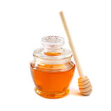 Image of honey glass jar. rosh hashanah (jewesh holiday) concept. traditional holiday symbols. isolated on white Stock Photos