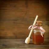 Image of honey glass jar. rosh hashanah (jewish holiday) concept. traditional holiday symbols. Royalty Free Stock Image