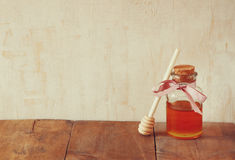 Image of honey glass jar. rosh hashanah (jewish holiday) concept. traditional holiday symbols. Royalty Free Stock Images