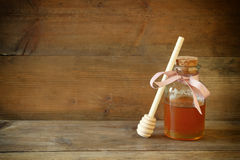 Image of honey glass jar. rosh hashanah (jewish holiday) concept. traditional holiday symbols. Royalty Free Stock Photography