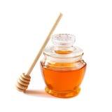 Image of honey glass jar. rosh hashanah (jewish holiday) concept. traditional holiday symbols. isolated on white Royalty Free Stock Images