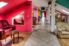 Hotel Lounge. Image of a hotel lounge with a corridor and armchairs Stock Photos