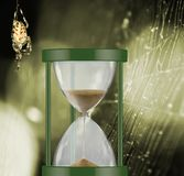Image of hourglass and spider on a blurred background. Image of hourglass and spider on blurred background royalty free stock photography