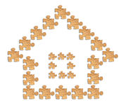 Image of a house made of wooden figures puzzles Royalty Free Stock Photography