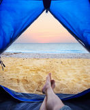 Image human legs lying in tourist tent Stock Photography
