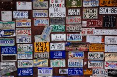 Hundreds of visitor`s license plates posted in Watson Lake, Yukon. A image of hundreds of visitor`s license plates posted in Watson Lake, Yukon stock photography