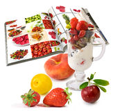 Image of Ice cream with fruit and magazine closeup Stock Photo