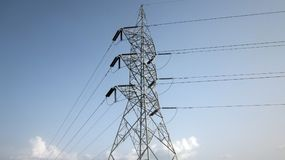 High Tension Wire and the sky. Image is image of high tension wire connecting one to another through high and reliable wires Stock Photo