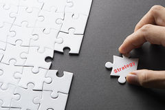 Image of incomplete missing puzzle peace STRATEGY Stock Photo