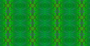 IRIDESCENT GREEN REPEAT PATTERN. Image of an intricate repeat pattern in pearly iridescent green colours stock photography