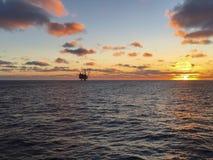 Oil Rigg at Sun Set on the North Sea Scotland. Image of an iol rigg taken on the North Sea at sunset stock photos