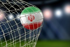 Iranian soccerball in net. Image of Iranian soccerball in net Royalty Free Stock Image