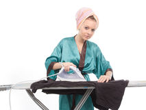 The image of ironing girl Stock Image