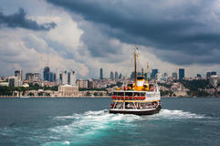 Image of Istanbul on a stormy day. A ferry boat crossing the Bosphorus on a rainy day in Istanbul Stock Photo
