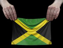 Jamaican flag in hands. Image of Jamaican flag in hands stock images