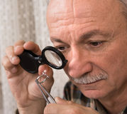 Image of jeweler examining jewel Royalty Free Stock Image