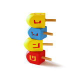 Wooden colorful dreidels (spinning top) for hanukkah jewish holiday isolated on white   Royalty Free Stock Photography