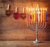 Image of jewish holiday Hanukkah background with menorah (traditional candelabra) and Burning candles   Stock Photography