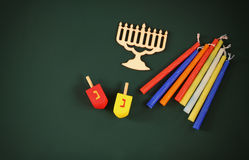 Image of jewish holiday Hanukkah with wooden decorative menorah (traditional Candelabra) and wooden dreidels spinning top Stock Image