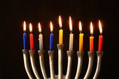 Image of jewish holiday Hanukkah background with menorah (traditional candelabra) and Burning candles Stock Photos