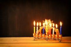 Image of jewish holiday Hanukkah background with menorah (traditional candelabra) and Burning candles Royalty Free Stock Photos