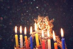 Image of jewish holiday Hanukkah background with menorah (traditional candelabra) Burning candles over black background Royalty Free Stock Photos