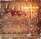 Image of jewish holiday Hanukkah background with menorah (traditional candelabra) and Burning candles. abstract snow overlay Stock Photography