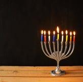 Image of jewish holiday Hanukkah background with menorah (traditional candelabra) Burning candles over black background Stock Images