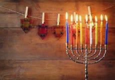 Image of jewish holiday Hanukkah background with menorah (traditional candelabra) and Burning candles Royalty Free Stock Photo