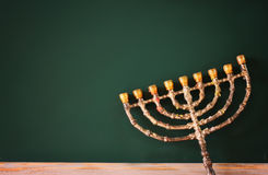 image of jewish holiday Hanukkah with menorah (traditional Candelabra) over chalkboard background, room for text royalty free stock image
