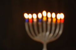 Abstract blurred background of jewish holiday Hanukkah background with menorah (traditional candelabra) Burning candles Stock Image