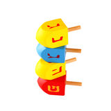 Wooden colorful dreidels (spinning top) for hanukkah jewish holiday isolated on white   Stock Image