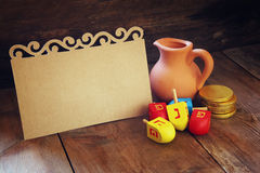 Image of jewish holiday Hanukkah and wooden dreidels (spinning top) with empty card for adding text Stock Photography