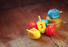 Image of jewish holiday Hanukkah and wooden dreidels (spinning top). retro filtered image Stock Images