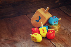 Image of jewish holiday Hanukkah and wooden dreidels (spinning top) Stock Photography
