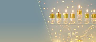 Image of jewish holiday Hanukkah background with crystal menorah & x28;traditional candelabra& x29; and candles. Image of jewish holiday Hanukkah background royalty free stock image