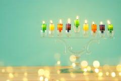 Image of jewish holiday Hanukkah background with crystal menorah & x28;traditional candelabra& x29; and colorful oil candles. Image of jewish holiday Hanukkah royalty free stock photo
