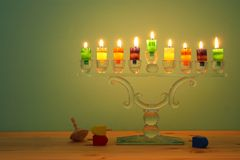 Image of jewish holiday Hanukkah background with crystal menorah & x28;traditional candelabra& x29; and colorful oil candles. Image of jewish holiday Hanukkah stock images