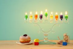 Image of jewish holiday Hanukkah background with crystal menorah & x28;traditional candelabra& x29; and colorful oil candles. Image of jewish holiday Hanukkah royalty free stock photography