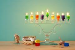 Image of jewish holiday Hanukkah background with crystal menorah & x28;traditional candelabra& x29; and colorful oil candles. Image of jewish holiday Hanukkah stock image