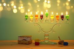 Image of jewish holiday Hanukkah background with crystal menorah & x28;traditional candelabra& x29; and colorful oil candles. Image of jewish holiday Hanukkah stock photography